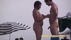 Frisky Nudist Amateurs Beach Voyeur Thumb
