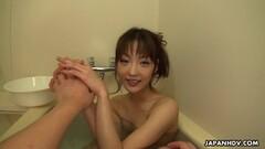 Asian babe sucking a pole in a bath tub Thumb